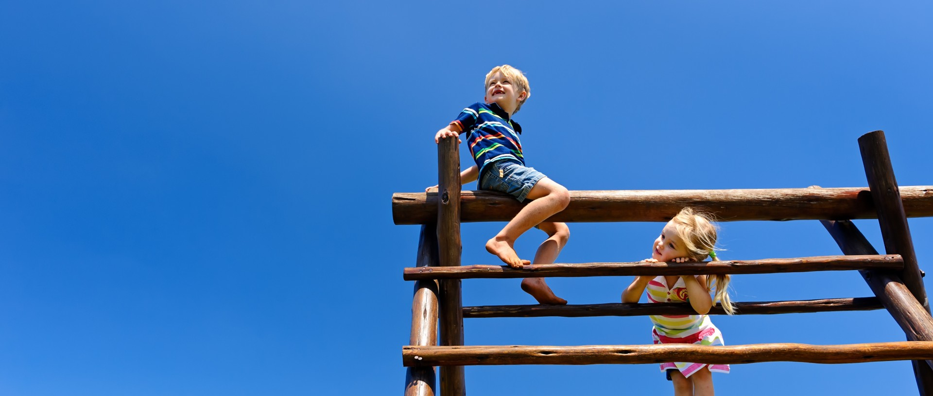 children playing on climbing bars